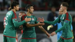 Lokomotiv Moscow's players celebrate their victory over Skenderbeu Korce in their Europa League group H soccer match in Moscow