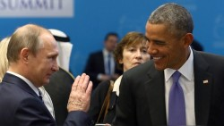 U.S. President Obama chats with Russia's President Putin prior to working session G20 summit in Antalya