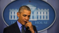 Obama pauses as he holds his end of the year news conference at the White House in Washington