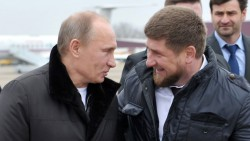 Russia's Prime Minister Vladimir Putin (L) speaks with Chechnya's leader Ramzan Kadyrov  (R) while arriving in the province's second-largest city, Gudermes, on December 20, 2011.  AFP PHOTO/ RIA-NOVOSTI/ALEXEI NIKOLSKY
