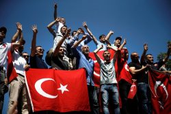 Supporters of Turkish President Tayyip Erdogan shout slogans and wave Turkish national flags during a pro-government demonstration in Sarachane park in Istanbul, Turkey, July 19, 2016. REUTERS/Alkis Konstantinidis