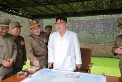 FILE PHOTO - North Korean leader Kim provides field guidance during a fire drill of ballistic rockets by Hwasong artillery units of the KPA Strategic Force, in this undated photo released by KCNA in Pyongyang